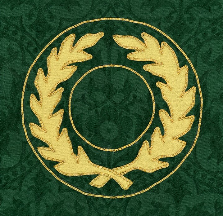 Gold wreath sewn on a green background